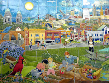 The 9' X 14' ceramic mural by Gregory Aliberti, entitled 'Strive for Harmony'. The mural hangs in the community room of the Rapid Station.
