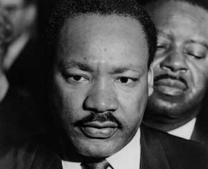 Martin Luther King in Memphis 1968 for the garbage workers' strike; click for a video of the mountaintop speech, his last public speech