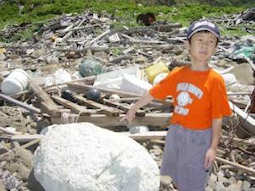 A boy in Japan points out Styrofoam debris from the ocean. (Credit: Katsuhiko Saido)