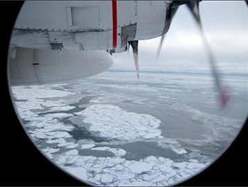 Broken Arctic sea ice as seen from a window in from a U.S. Coast Guard C130 flight over the Arctic Ocean September 30, 2009