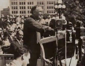 President Franklin Roosevelt speaking in 1936 about confronting greed-dominated government. Click to play the video.